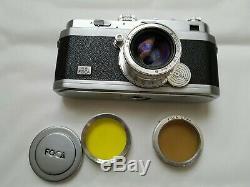 Ancien objectif OPLAREX 11.9 F=5cm+ appareil photo FOCA