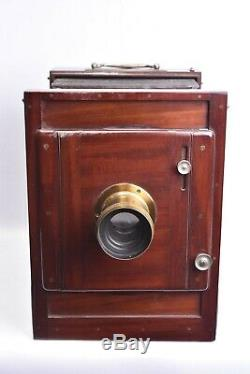 Appareil photographique 18 x 24 cm en acajou avec objectif Vulga