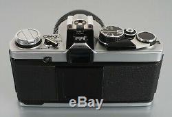 OLYMPUS OM-2N corps noir et chrome avec Zuiko 50 mm f1,8 + Zuiko 75-150 mm f4