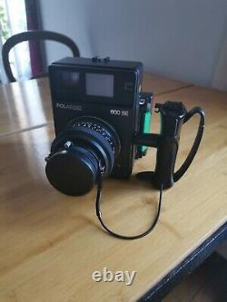 Polaroid 600 SE + dos pack + objectif 127 mm 4.7