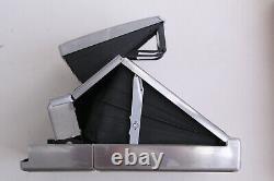 Polaroid SX-70 marron (1ère photo sort puis n'éjecte plus)